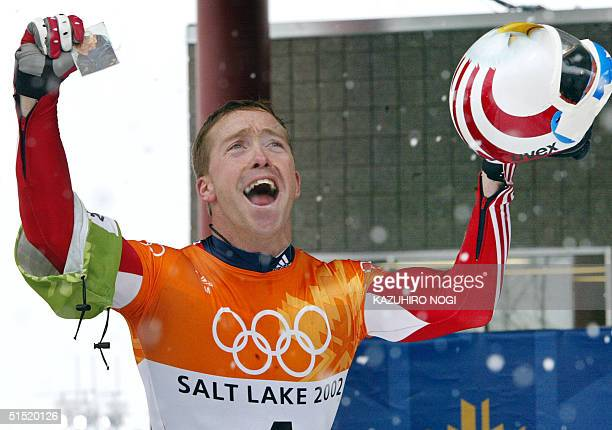 Jim Shea celebrates his gold medal on the finish line during the men's skeleton event for the Salt Lake 2002 Olympic Winter Games at the Utah Olympic...