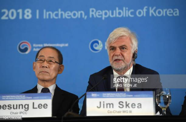 Jim Skea cochir of the IPCC Working Group III speaks as Hoesung Lee chair of the IPCC listens to during a press conference of the Intergovernmental...