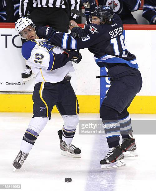 Jim Slater of the Winnipeg Jets collides with Andy McDonald of the St Louis Blues in NHL action at the MTS Centre on February 25 2012 in Winnipeg...