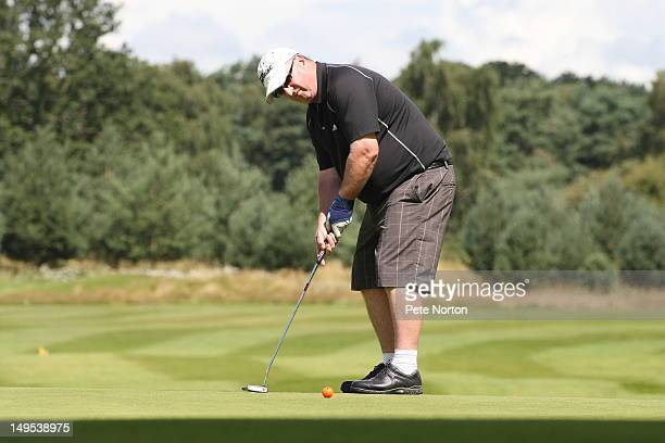 Jim Smith of Southwick Park Golf Club putts on the 1st green during the Virgin Atlantic PGA National ProAm Championship Regional Final at Frilford...