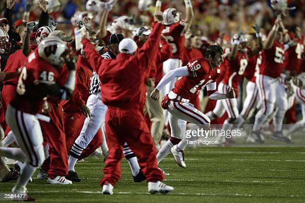 Jim Sorgi of the Wisconsin Badgers celebrates with his teammates at the end of the game against the Ohio State Buckeyes on October 11 2003 at Camp...