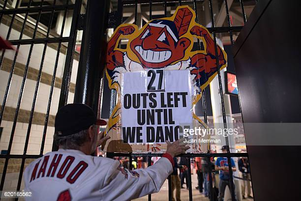 Jim Stamper of Cleveland hangs a sign outside of Progressive Field during game 6 of the World Series against the Chicago Cubs on November 1 2016 in...