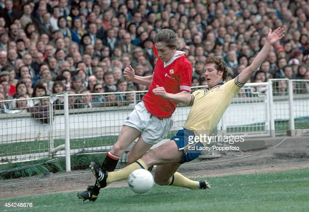 Jim Steele of Southampton slides in to tackle Gerry Daly of Manchester United during the FA Cup Final at Wembley Stadium in London on 1st May 1976...