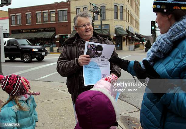 Jim Strauss senior editor at the Geneva Shore Report gives a Save Charlotte poster to Demetra Condos in Lake Geneva Wisconsin on Thursday December 15...
