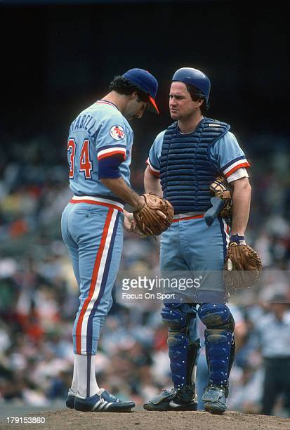 Jim Sundberg of the Texas Rangers talks with his pitcher Paul Mirabella against the New York Yankees during an Major League Baseball game circa 1982...