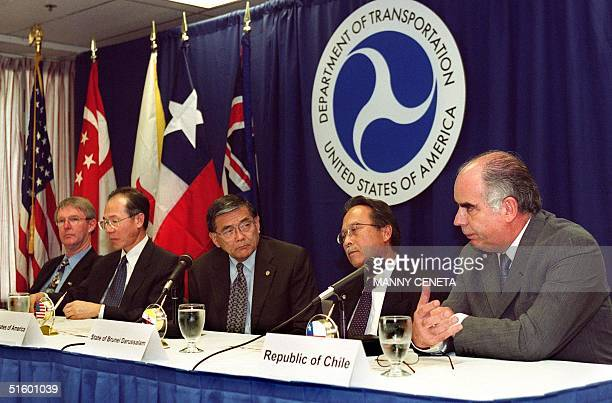 Jim Sutton New Zealand's Minister for Trade Negotiations Yeo Cheow Tong Singapore's Minister for Communications and Information Technology US...
