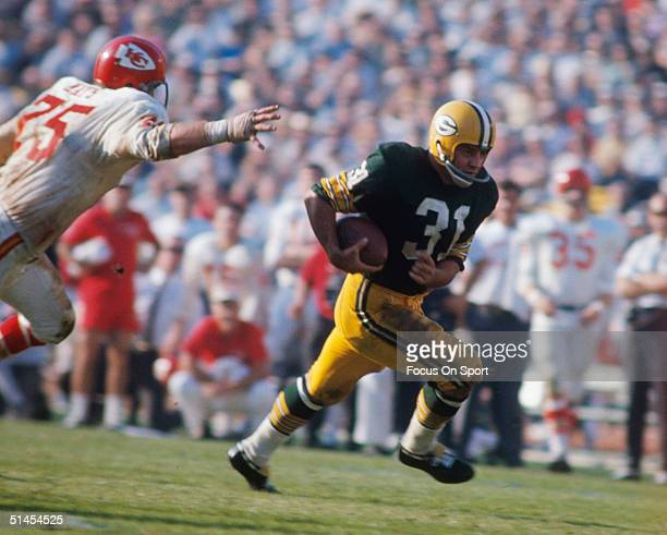 Jim Taylor of the Green Bay Packers runs during Super Bowl I against the Kansas City Chiefs at Memorial Coliseum on October 15 1967 in Los Angeles...
