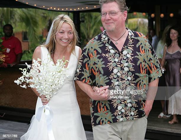 Jim the uncle of the bride walks Lhotse Merriam down the aisle at her wedding ceremony January 12 2006 on the Island of Tavarua in Fiji
