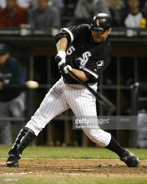 Jim Thome DH of the Chicago White Sox singles in what turned out to be the winning run during game action at US Cellular Field Chicago Illinois on...