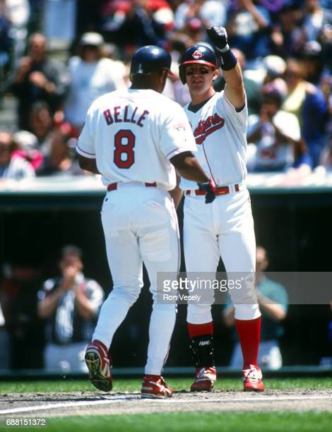 Jim Thome greets Albert Belle of the Cleveland Indians after Belle hit a home run in an MLB game at Jacobs Field in Cleveland Ohio Thome played for...