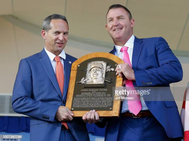 Jim Thome is presented his plaque from Hall of Fame President Jeff Idelson at Clark Sports Center during the Baseball Hall of Fame induction ceremony...