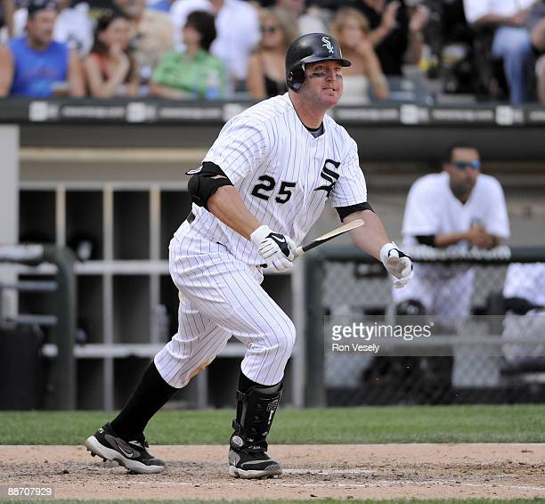 Jim Thome of the Chicago White Sox follows through after hitting a two run double in the eighth inning against the Chicago Cubs on June 26 2009 at US...