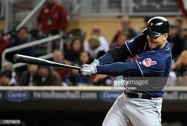 Jim Thome of the Cleveland Indians hits a solo home run against the Minnesota Twins in the ninth inning on September 16 2011 at Target Field in...