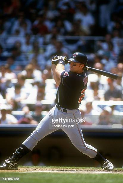 Jim Thome of the Cleveland Indians swings and watches the flight of his ball against the New York Yankees during a Major League Baseball game circa...