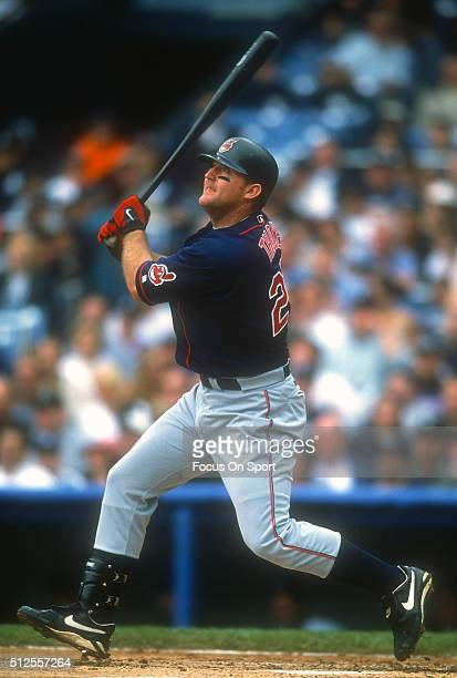 Jim Thome of the Cleveland Indians swings and watches the flight of his ball against the Detroit Tigers during a Major League Baseball game circa...