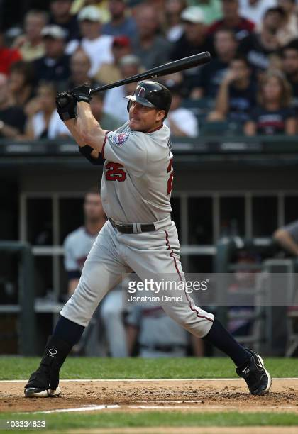Jim Thome of the Minnesota Twins hits the first pitch he sees of the game for a home run against the Chicago White Sox at US Cellular Field on August...