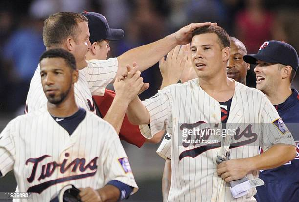 Jim Thome of the Minnesota Twins rubs the head of Danny Valencia of the Minnesota Twins after the win against the Cleveland Indians on July 19 2011...