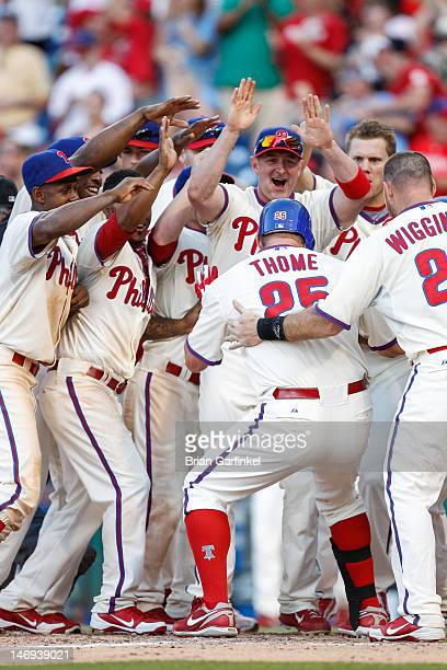 Jim Thome of the Philadelphia Phillies puts his foot on home plate after hitting a home run in the bottom of the ninth inning to win the game against...