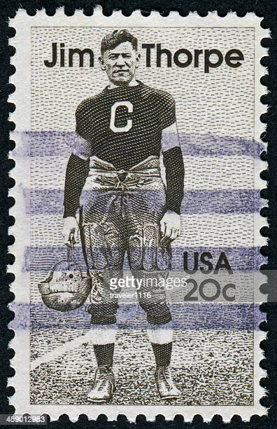 jim thorpe stamp - old american football stock photos and pictures