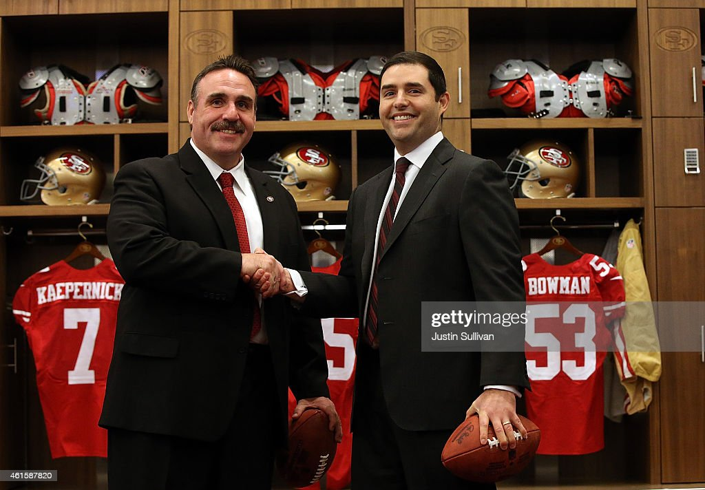 Jim Tomsula (L) shakes hands with San Francisco 49ers CEO Jed York (R) following a press conference at Levi's Stadium on January 15, 2015 in Santa Clara, California. The San Francisco 49ers announced Jim Tomsula as their new head coach to replace Jim Harbaugh.