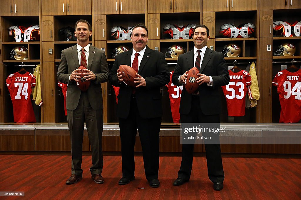 Jim Tomsula (C) stands with San Francisco 49ers CEO Jed York (R) and 49ers general manager Trent Baalke following a press conference at Levi's Stadium on January 15, 2015 in Santa Clara, California. The San Francisco 49ers announced Jim Tomsula as their new head coach to replace Jim Harbaugh.