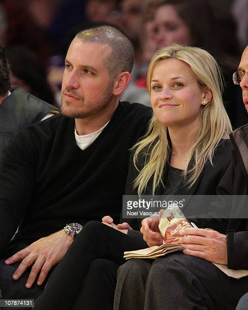 Jim Toth and Reese Witherspoon attend a game between the Detroit Pistons and the Los Angeles Lakers at Staples Center on January 4, 2011 in Los...