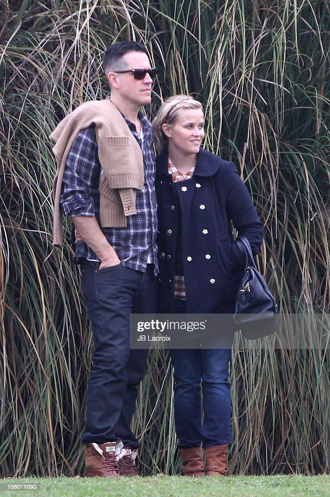 Jim Toth and Reese Witherspoon attend a soccer game in Pacific Palisades on December 8, 2012 in Los Angeles, California.
