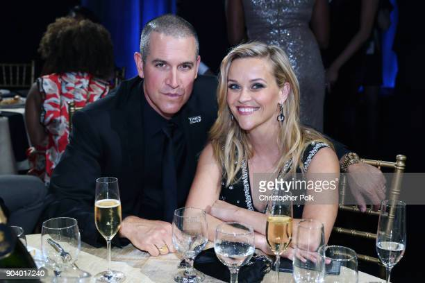 Jim Toth and Reese Witherspoon attend The 23rd Annual Critics' Choice Awards at Barker Hangar on January 11, 2018 in Santa Monica, California.