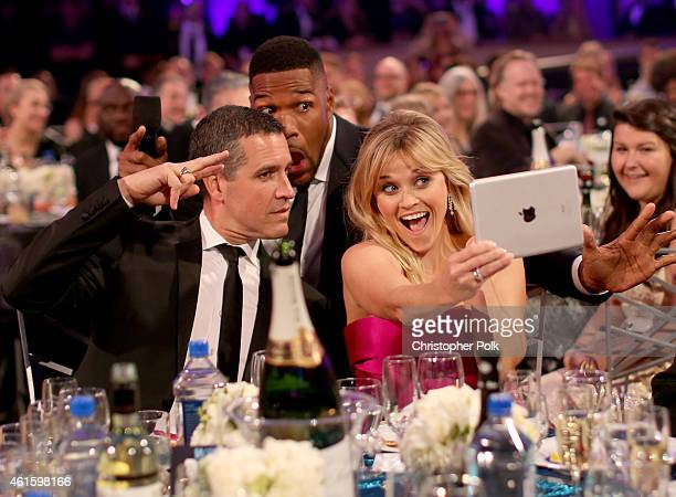 Jim Toth, host Michael Strahan and actress Reese Witherspoon pose for selfies during the 20th annual Critics' Choice Movie Awards at the Hollywood...