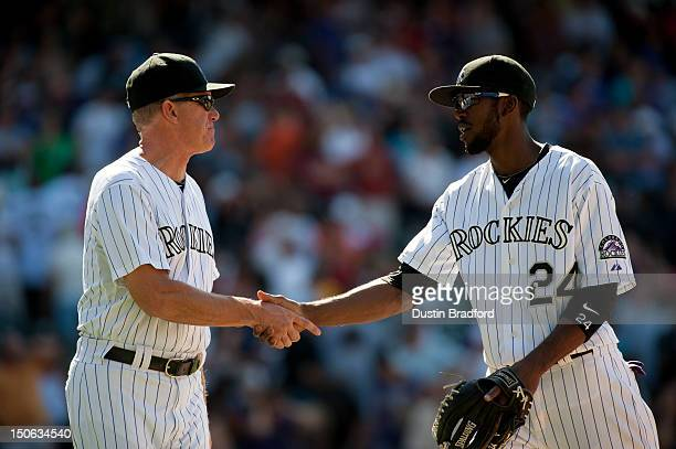 Jim Tracy of the Colorado Rockies congratulates Dexter Fowler after a game against the Miami Marlins at Coors Field on August 19 2012 in Denver...