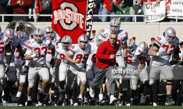 Jim Tressel, head coach of the Ohio State Buckeyes, leads his team onto the field for a game against the Michigan State Spartans on October 14, 2006...