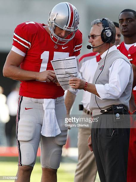 Jim Tressel head coach of the Ohio State Buckeyes talks with Todd Boeckman during a game against the Michigan State Spartans at Ohio Stadium October...