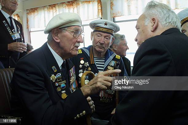 Jim Underwood a British World War II veteran of the Arctic Convoys reminisces about the past with a Russian comrade August 31 2001 in Archangelsk...