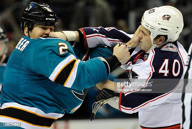 Jim Vandermeer of the San Jose Sharks exchanges punches with Jared Boll of the Columbus Blue Jackets for a second time during an NHL hockey game at...