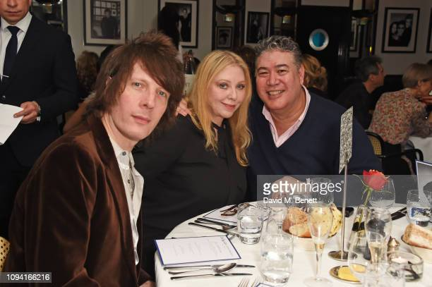 Jim Wallerstein, Bebe Buell and Jonathan Phang attend the launch of John Swannell's photography exhibition at Le Caprice on February 5, 2019 in...