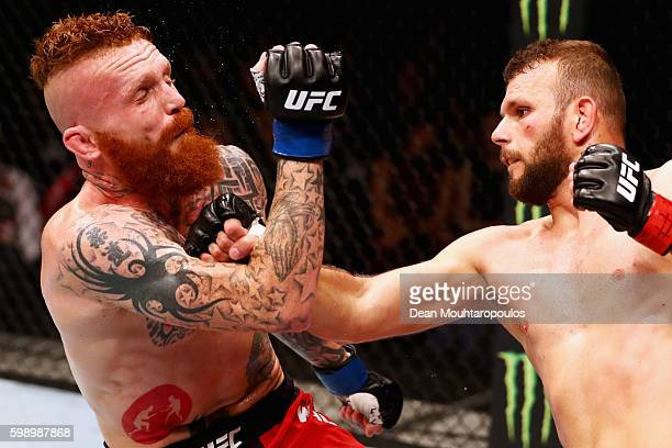 Jim Wallhead of England and Jessin Ayari of Germany compete in their Welterweight Bout during the UFC Fight Night held at Barclaycard Arena on...