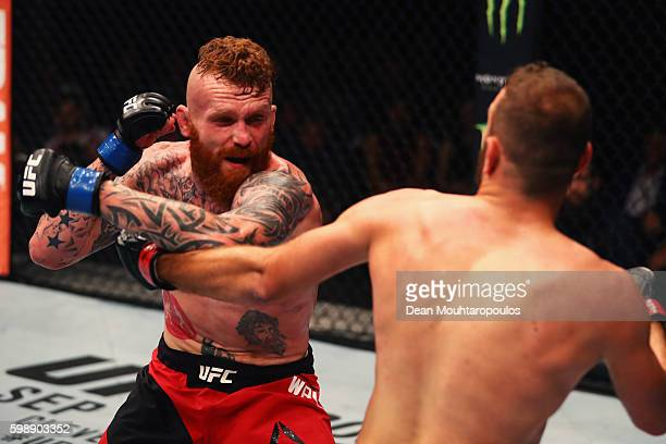 Jim Wallhead of England punches Jessin Ayari of Germany compete in their Welterweight Bout during the UFC Fight Night held at Barclaycard Arena on...