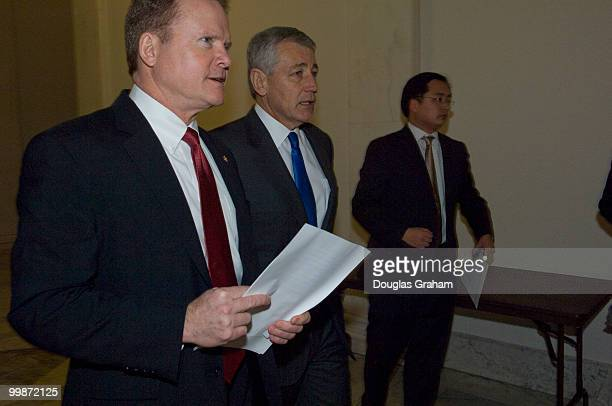 Jim Webb DVa and Chuck Hagel RNeb walk to a news conference to discuss the independent budget of leading veterans' organizations including policy...