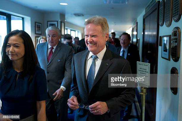 Jim Webb former Senator from Virginia and former 2016 Democratic presidential candidate center and his wife Hong Le Webb walk out after a news...