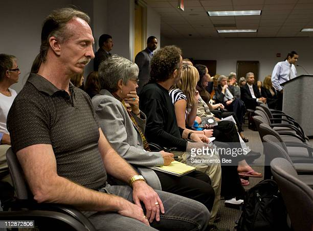 Jim Whitehouse left husband of convicted killer Susan Atkins listens to Joey Huertas right as he speaks in support of the pending compassionate...