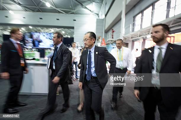 Jim Yong Kim president of the World Bank Group center walks through the media center for the Group of 20 summit in Brisbane Australia on Friday Nov...
