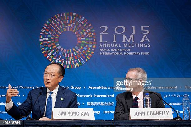 Jim Yong Kim president of the World Bank Group left speaks during a press briefing with his communications advisor John Donnelly at the World Bank...