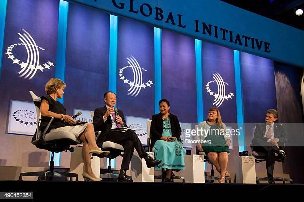 Jim Yong Kim president of the World Bank Group second left speaks on a panel with Judith Rodin president of The Rockefeller Foundation left Pelenise...