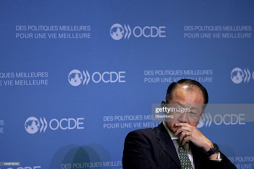 Jim Yong Kim, president of the World Bank Group, sits and listens during a news conference following a meeting hosted by the Organization for Economic Cooperation and Development (OECD) in Paris, France, on Monday, Oct. 29, 2012. French President Francois Hollande said he wants the euro group of finance ministers to find a 'durable' solution to Greece's debt problems at their November meeting. Photographer: Balint Porneczi/Bloomberg via Getty Images
