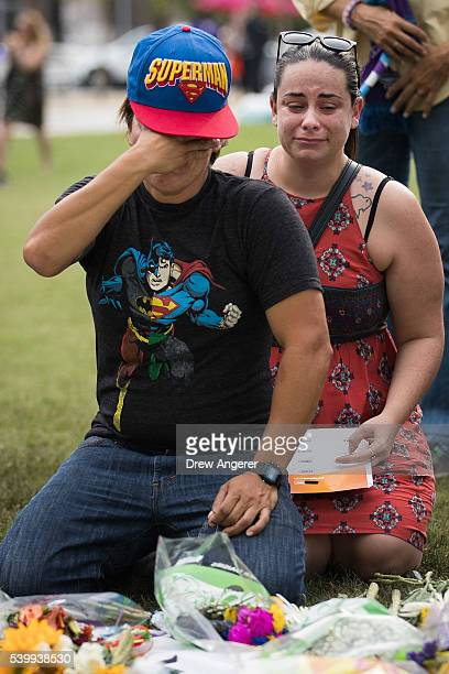 Jimaida Arrieta and Jessica Ellison cry at a makeshift memorial prior to an evening vigil for the victims of the Pulse Nightclub shootings at the Dr...