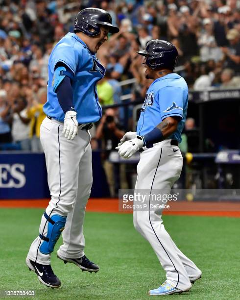 Ji-Man Choi celebrates with Wander Franco of the Tampa Bay Rays after hitting a three-run home run during the sixth inning against the Los Angeles...