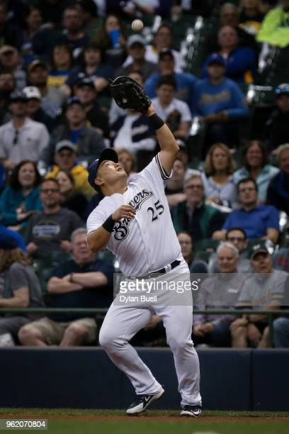 JiMan Choi of the Milwaukee Brewers catches a pop fly in the eighth inning against the Arizona Diamondbacks at Miller Park on May 22 2018 in...