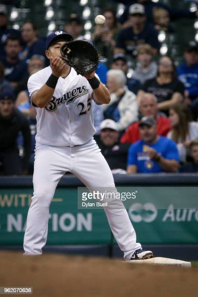 JiMan Choi of the Milwaukee Brewers catches the ball at first base for a force out in the fifth inning against the Arizona Diamondbacks at Miller...