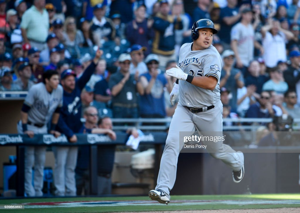 Ji-Man Choi #25 of the Milwaukee Brewers looks back as he scores during the twelfth inning on Opening Day against the San Diego Padres at PETCO Park on March 29, 2018 in San Diego, California.