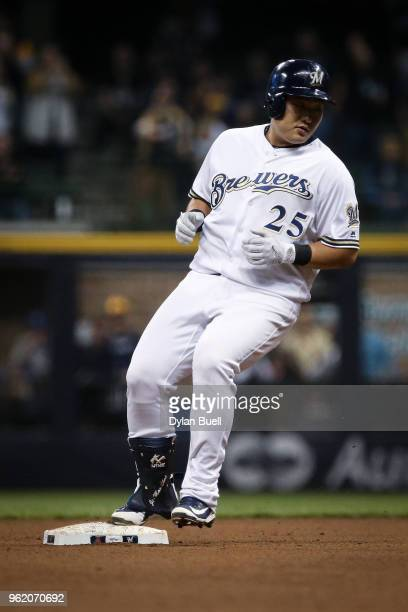JiMan Choi of the Milwaukee Brewers reaches second base for a double in the sixth inning against the Arizona Diamondbacks at Miller Park on May 22...